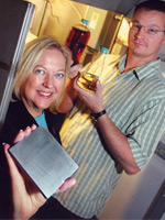 Dr. Patricia Irving holds the InnovaGen™ micro-channel reactor while Staff Engineer Jeff Pickles looks on - Tri-City Herald